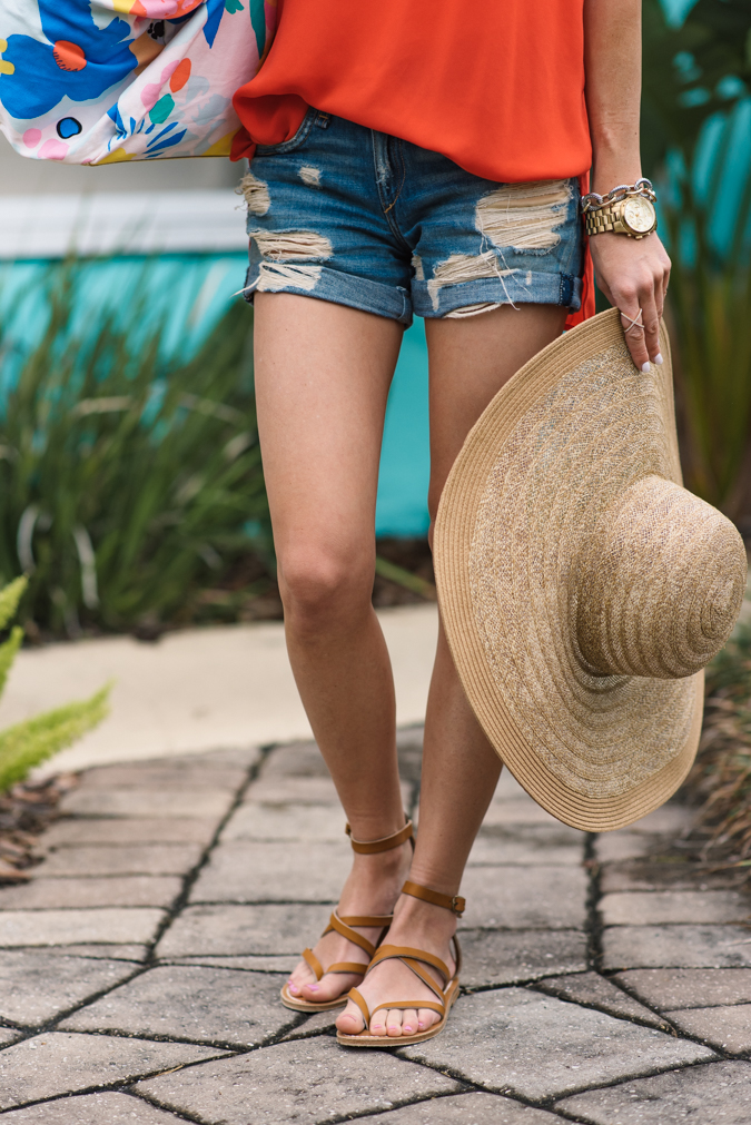 weekend getaway, ban.do duffle, floral duffle bag, straw hat, panama hat, brixton panama hat, brixton straw hat, lush side split tank, distressed denim shorts, red tank top, spring style, palm springs, jacksonville beach, summer style, floppy hat, rag & bone distressed denim shorts