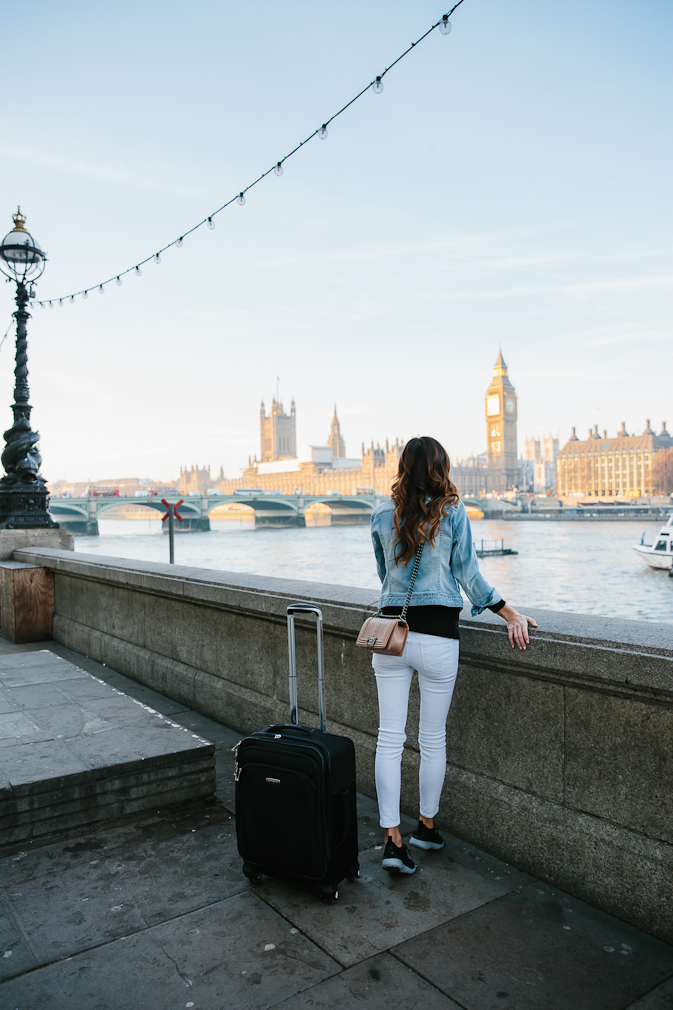brunette woman looking at view of big ben in london, london packing list, fall trip