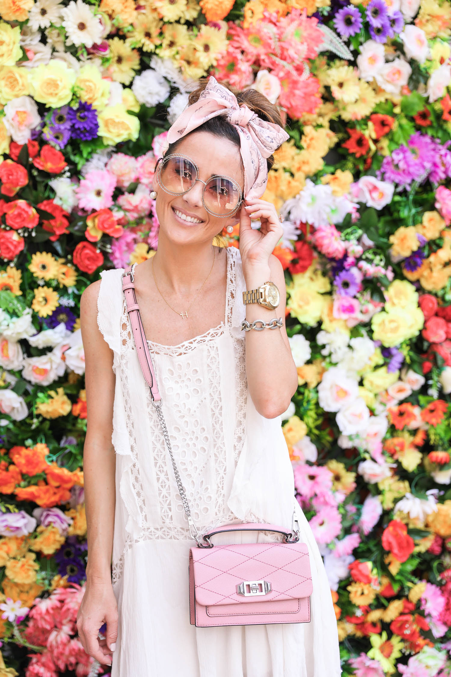 chloe round sunglasses, mytheresa.com, flower wall, lisbon, portugal, free people priscilla dress, rebecca minkoff pink cross body hangbag,