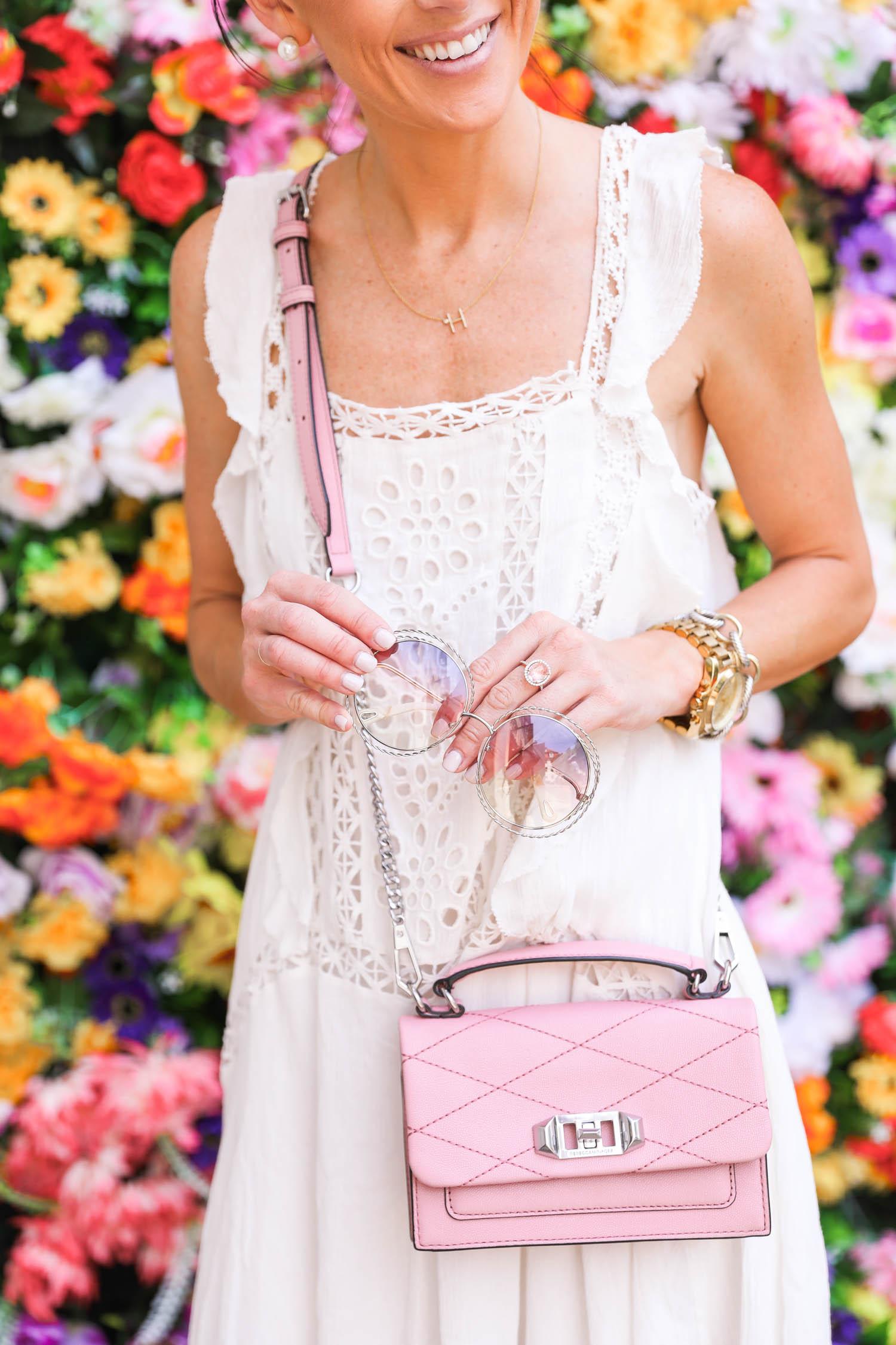 chloe round sunglasses, mytheresa.com, flower wall, lisbon, portugal, free people priscilla dress, rebecca minkoff pink cross body hangbag,