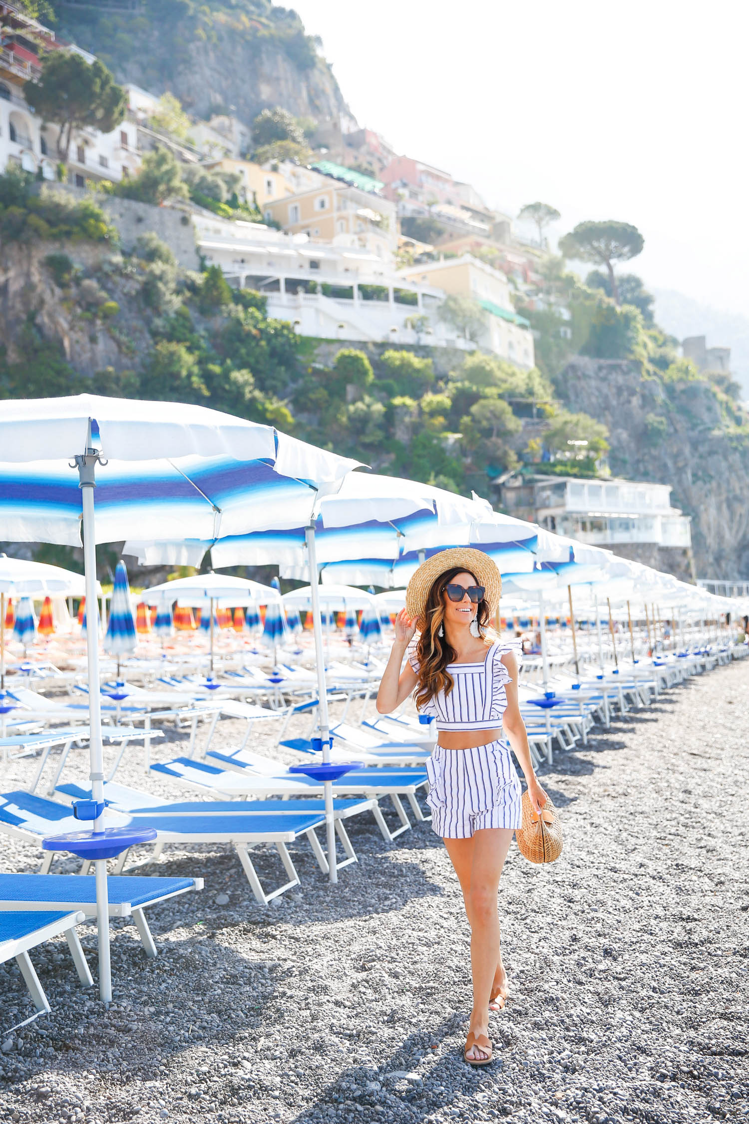 blue beach umbrellas, positano, amalfi coast, what to wear on the 4th of july, summer outfit inspiration, summer outfit idea, italy