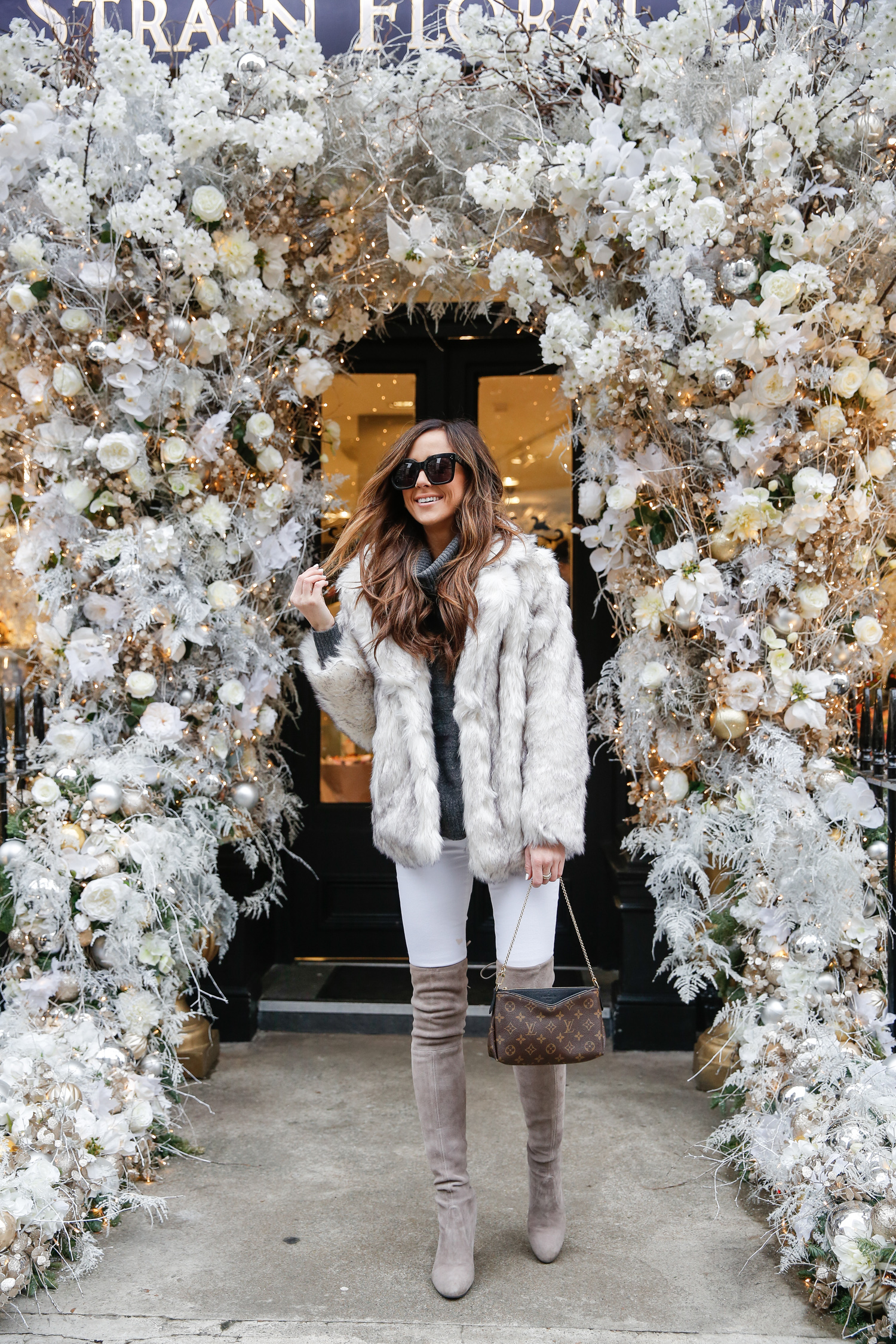 faux fur coat, floral display, london, over the knee boots