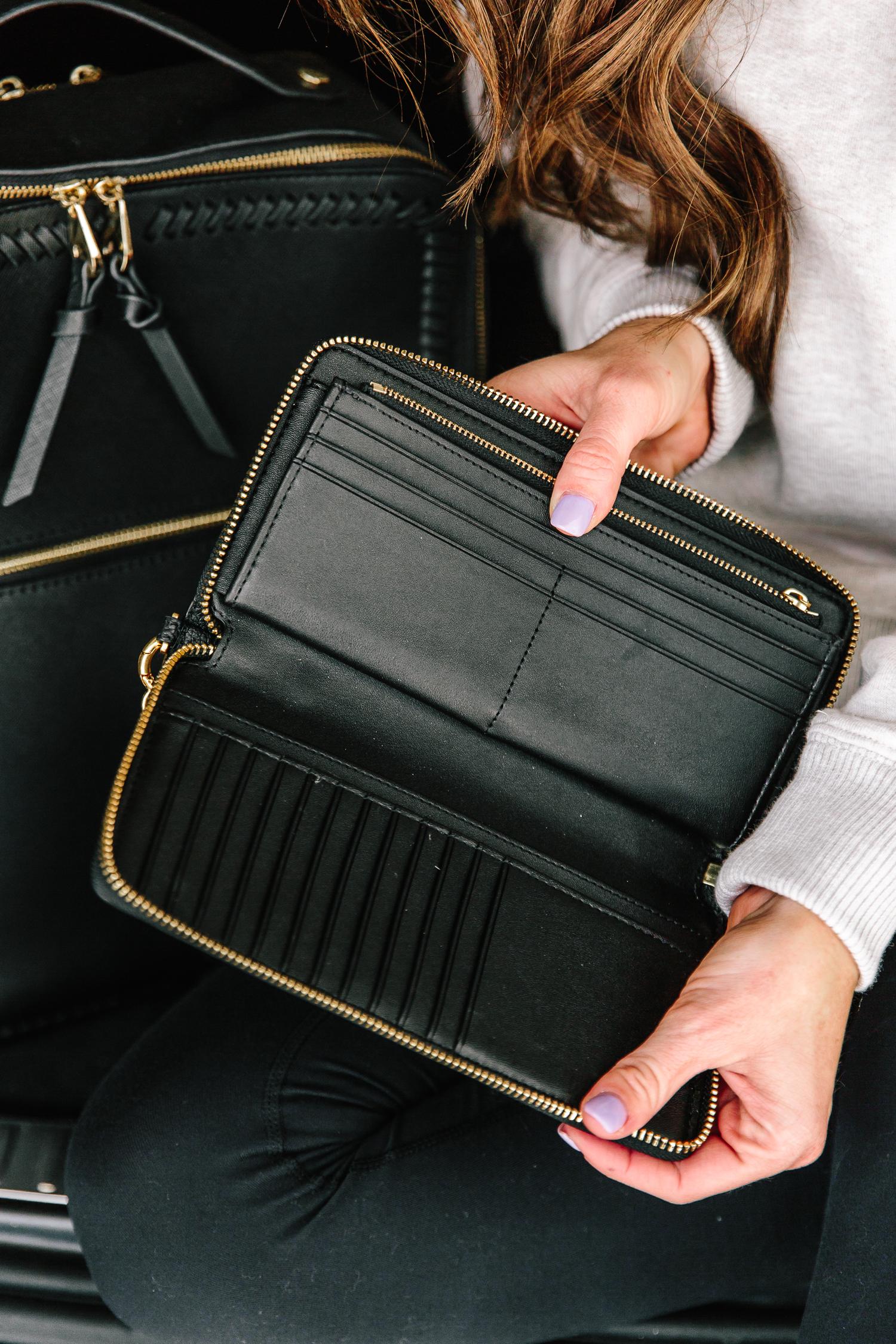 inside of black tory burch leather passport wallet